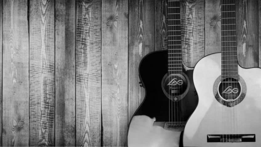 2 Acoustic Guitars Hanging