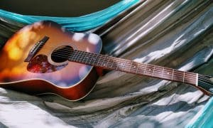best acoustic guitar brands - a sunburst colored acoustic guitar